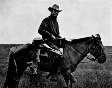 Roy Chapman Andrews on his horse Kublai Khan in Mongolia about 1920